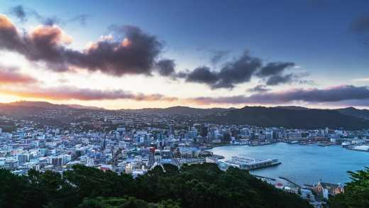 Oceania, New Zealand, view from above of wellington as the sun sets.