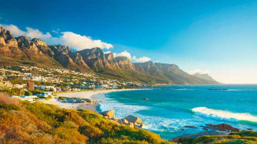 See the shores of Camps Bay and the Twelve Apostles mountain range on a Best of South Africa Tour