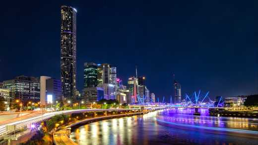 Oceania, Australia, the city lights of the Brisbane skyline glowing in the late evening.