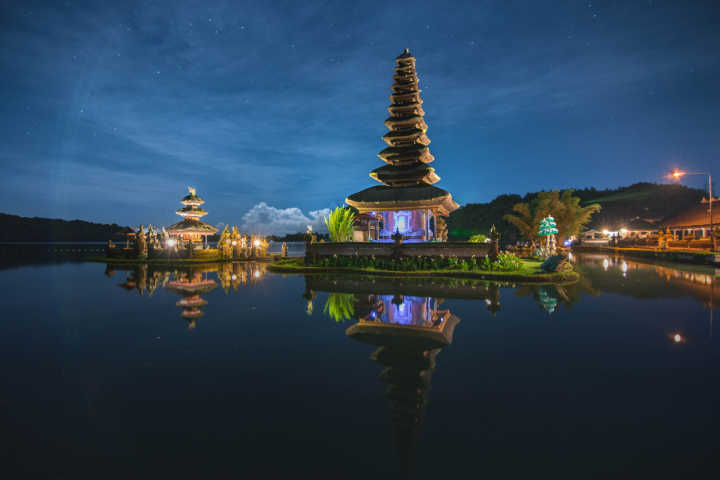 Discover the enchanting temples of Bali, pictured here at night, on a Bali vacation