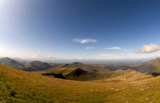 See Snowdonia on a sunny autumn afternoon with the train descending the mountain, on a tour of Wales