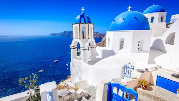 Discover beautiful Santorini, with its blue domes pictured here, on a Greece vacation