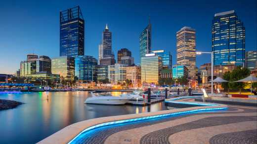 Oceania, Australia, city lights of the Perth skyline and harbor in the late evening.