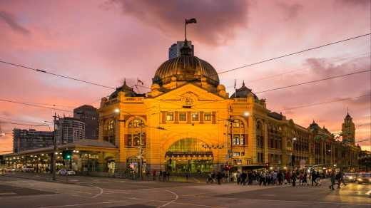 Oceania, Australia, Melbourne, frontlit view of the finders street station with a rose-colored sunset in the background.