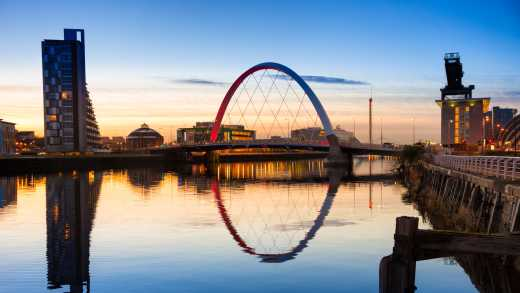 See the Finnieston Bridge at sunset on a Glasgow vacation