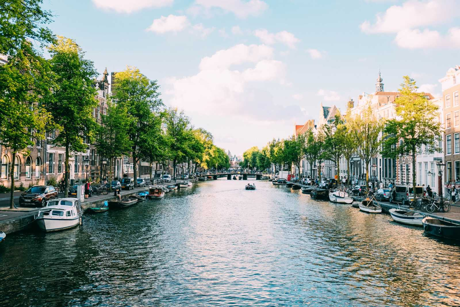 View of a canal in Amsterdam - to experience on an Amsterdam holiday