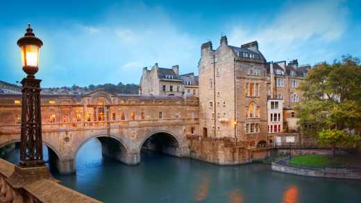 Visit the beautiful Pulteney Bridge in Bath, pictured here, on a Southern England tour