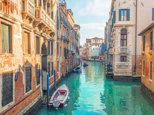 Discover beautiful canals and stunning architecture, pictured here, on a trip to Venice