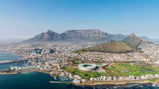 Discover the beautiful city of Cape Town, pictured here from above, on a cape town vacation