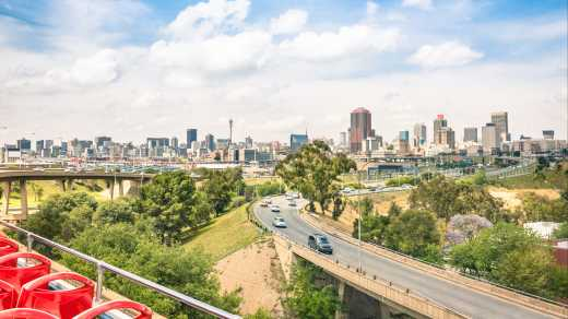 Africa, South Africa, freeway leading to the  Johannesburg skyline
