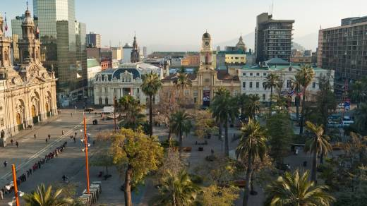 South America, Chile, Santiago de Chile, Plaza de Armas viewed from above, gentle sunlight and palm trees.