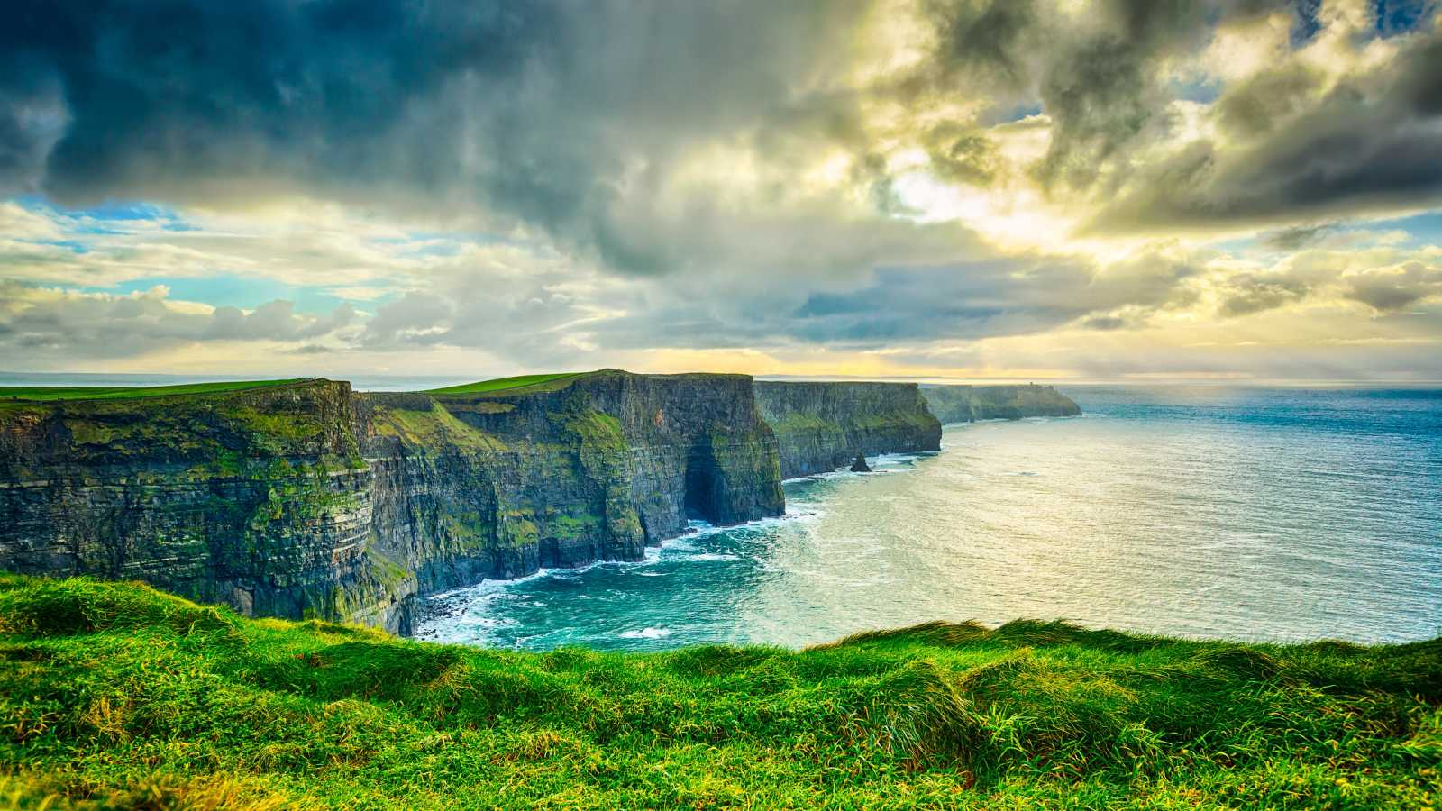 Europe, Ireland, Cliffs of Moher, grassy cliffs looking over the Atlantic Ocean.