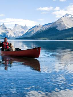 A man canoeing at Sea Maligne in the Rocky Mountains, Canada