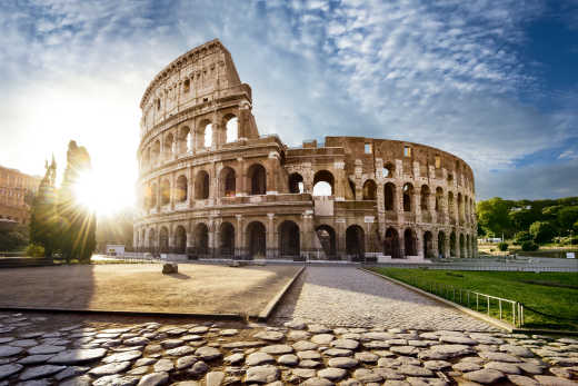 Discover the Colosseum, here pictured against a blue sky, on a Rome vacation