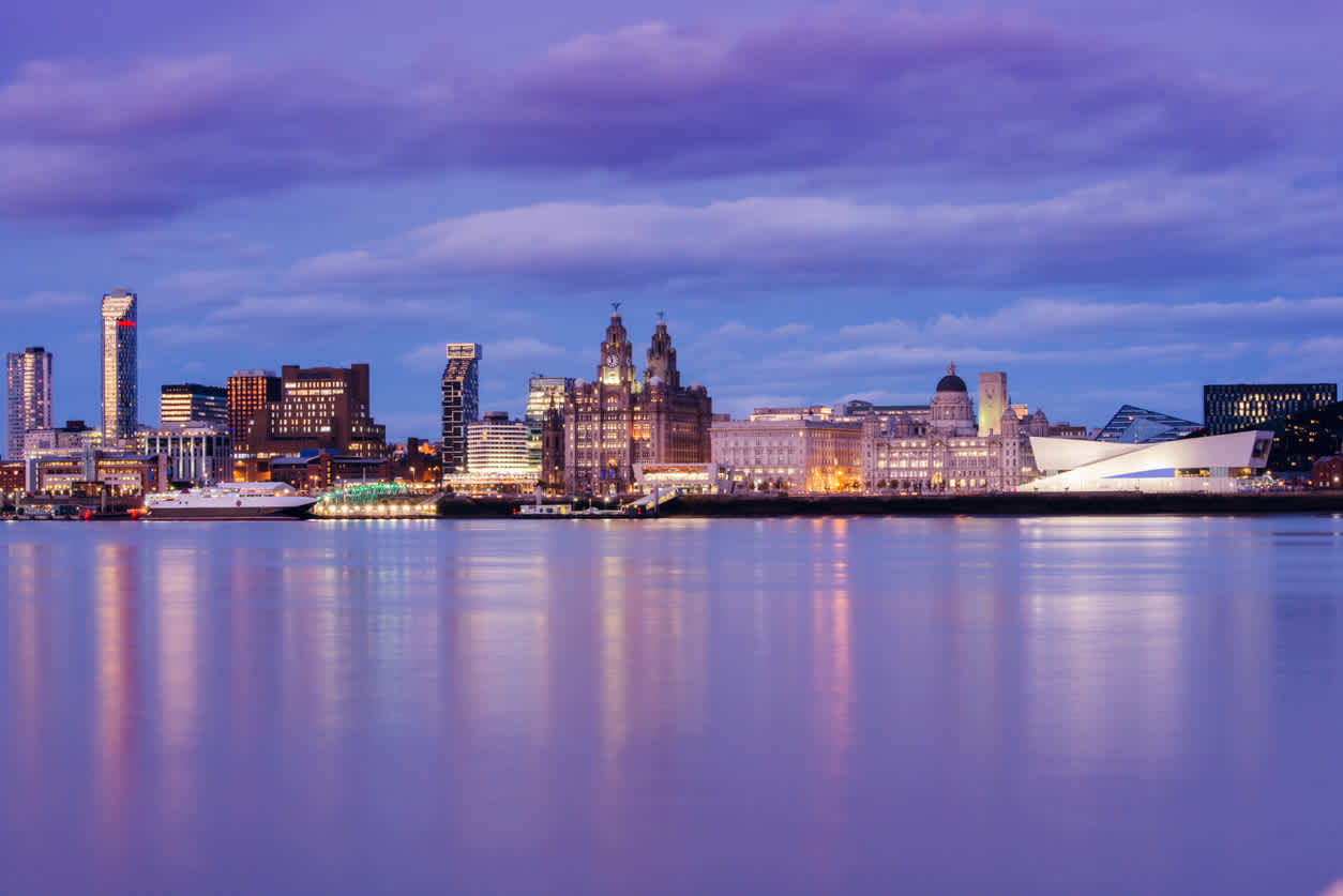 Discover the majestic waterfront city of Liverpool on a Liverpool vacation, pictured here at night