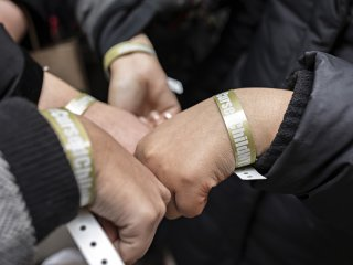 Fans gather their wristbands after queuing up for the first slew of preview shows for Cursed Child on Broadway