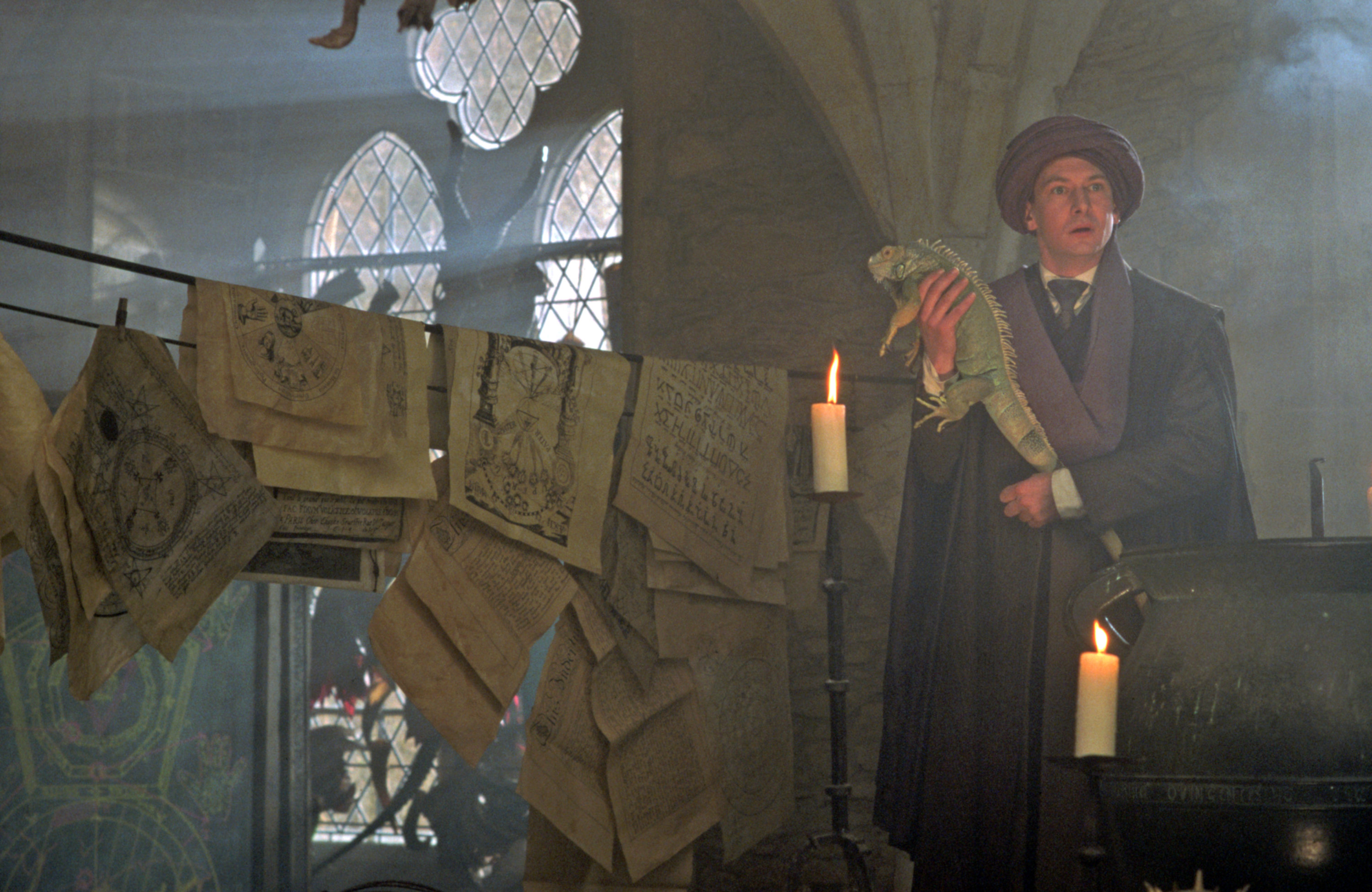Quirrell teaching in his classroom with a lizard