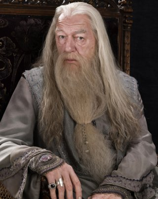 Dumbledore sitting in a chair from the Half Blood Prince
