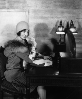 A flapper getting ready to write a letter