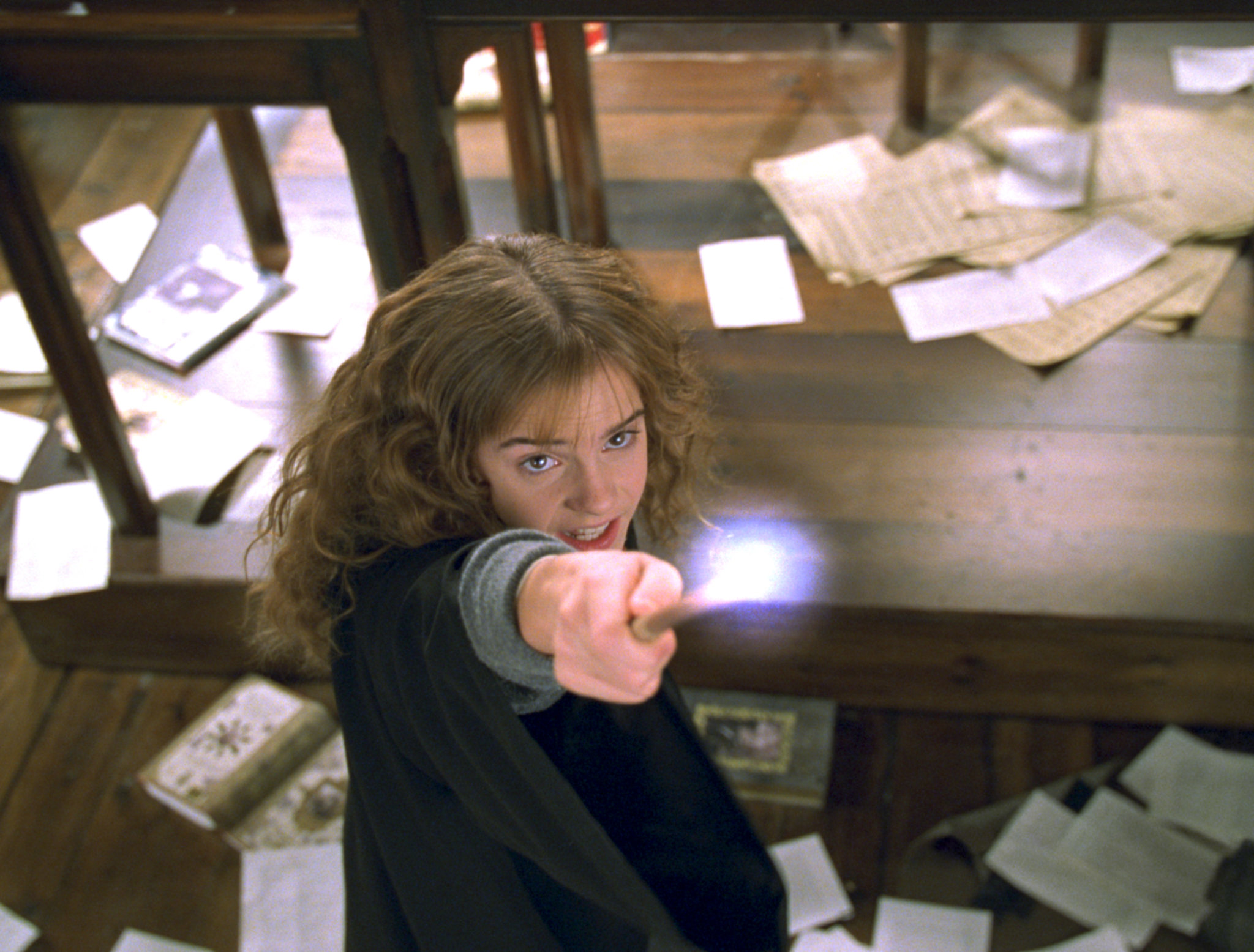 Hermione holding up her wand from the Chamber of Secrets