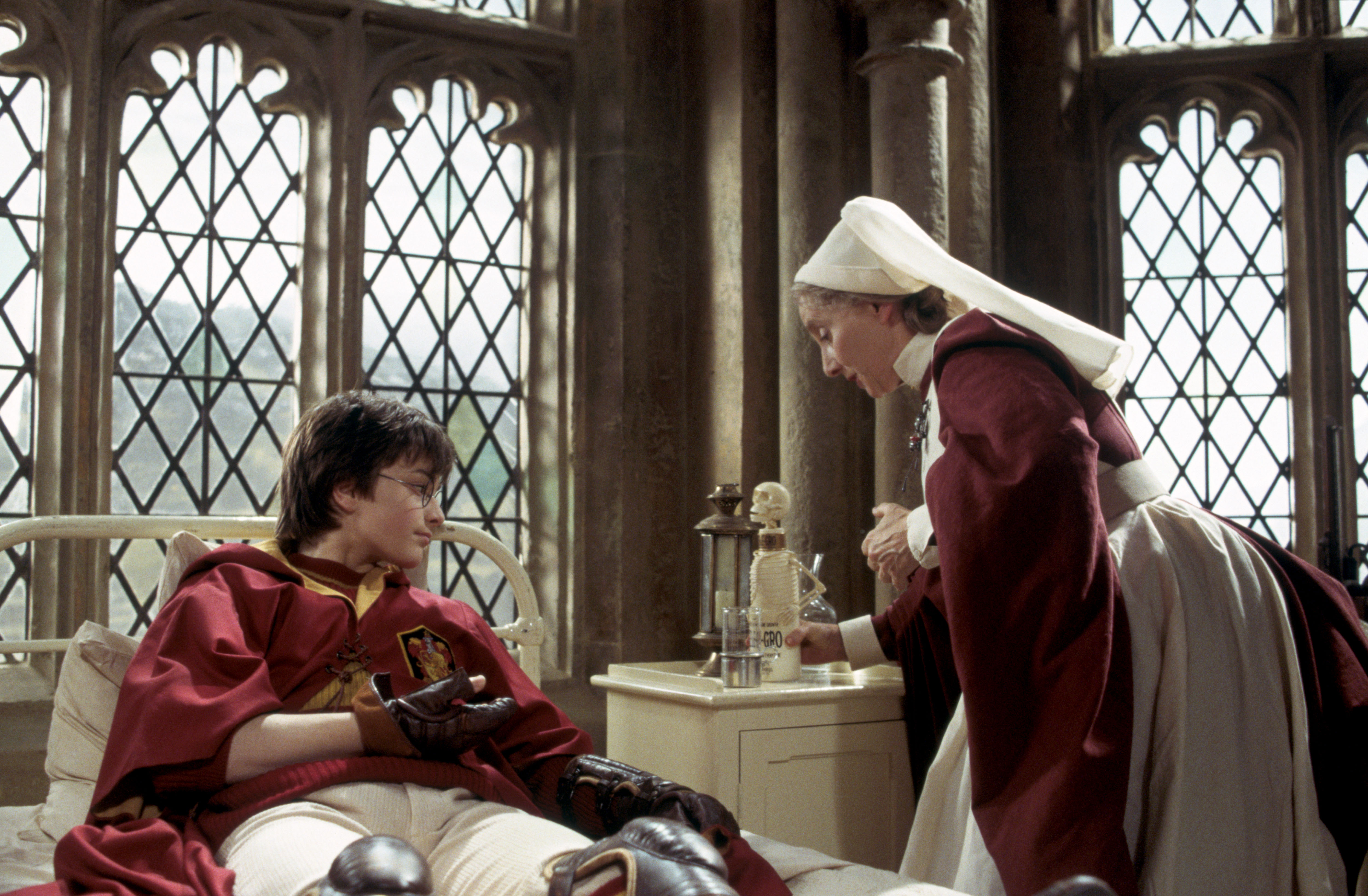 Madam Pomfrey tends to Harry with Skele-Gro after Lockhart removes all the bones in Harry's arm