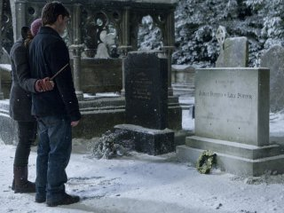 Harry and Hermione at the Potter's grave