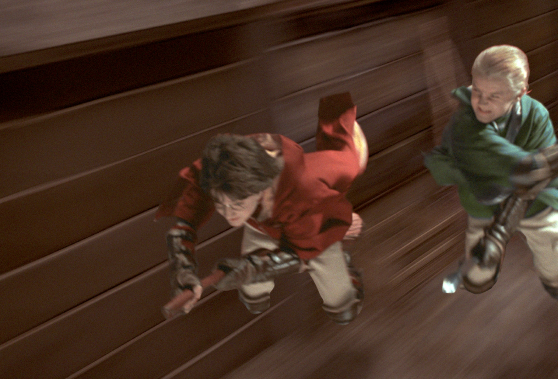 Harry and Draco race to the snitch in a quidditch match