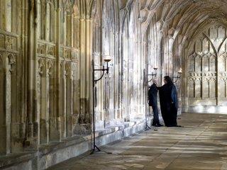 Snape threatens Draco in Hogwarts Hallway.