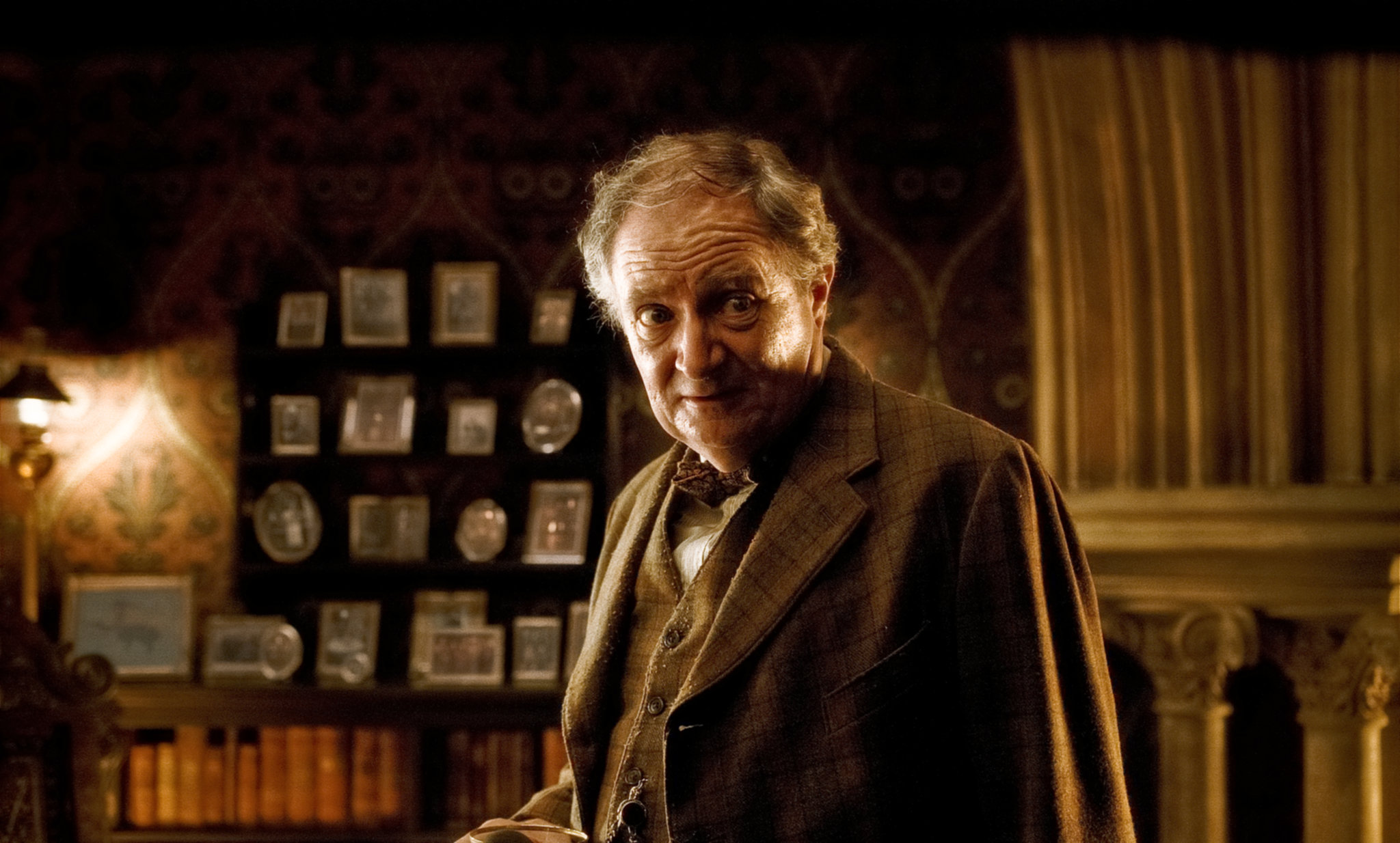 Professor Slughorn looks worried at the prospect of being asked about Tom Riddle