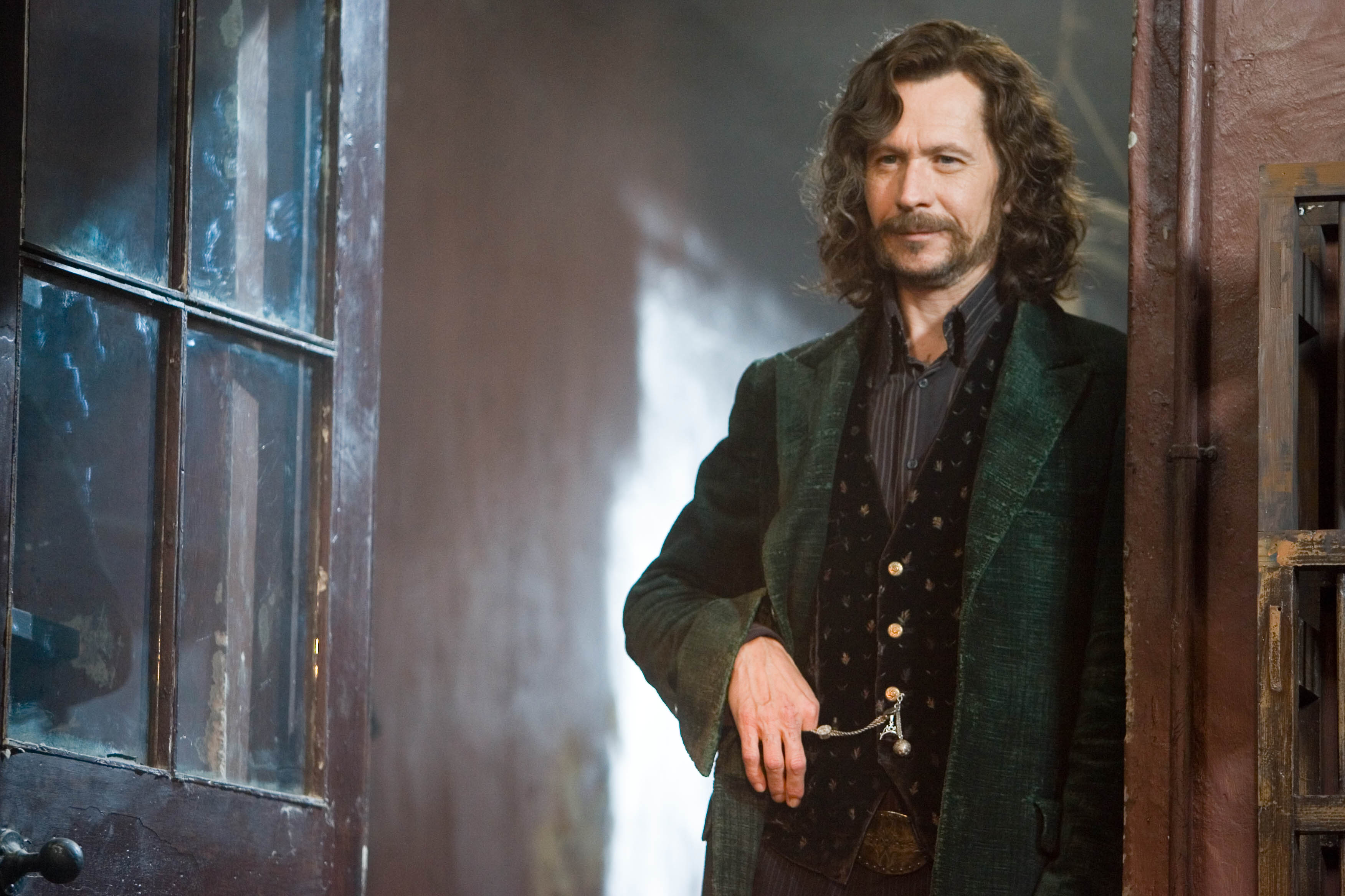 Sirius Black standing in doorway smiling