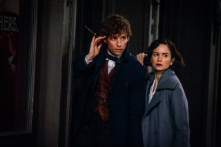 Newt and Tina outside, with their wands drawn