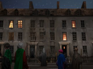 Members of the Order of the Phoenix stand outside Grimmauld Place.