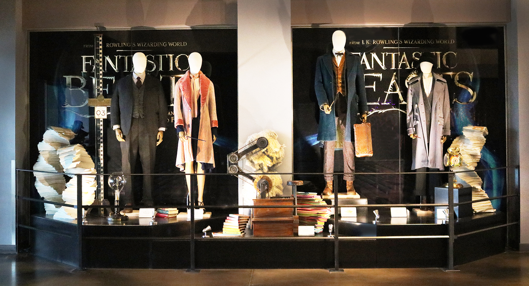 A display of the costumes belonging to the central four characters from Fantastic Beasts and Where to Find Them