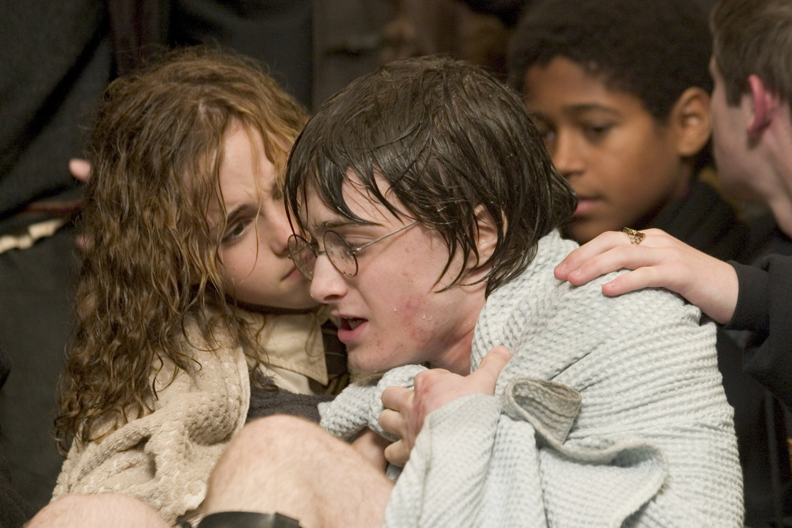 Hermione wrapping Harry in a towel after task 2