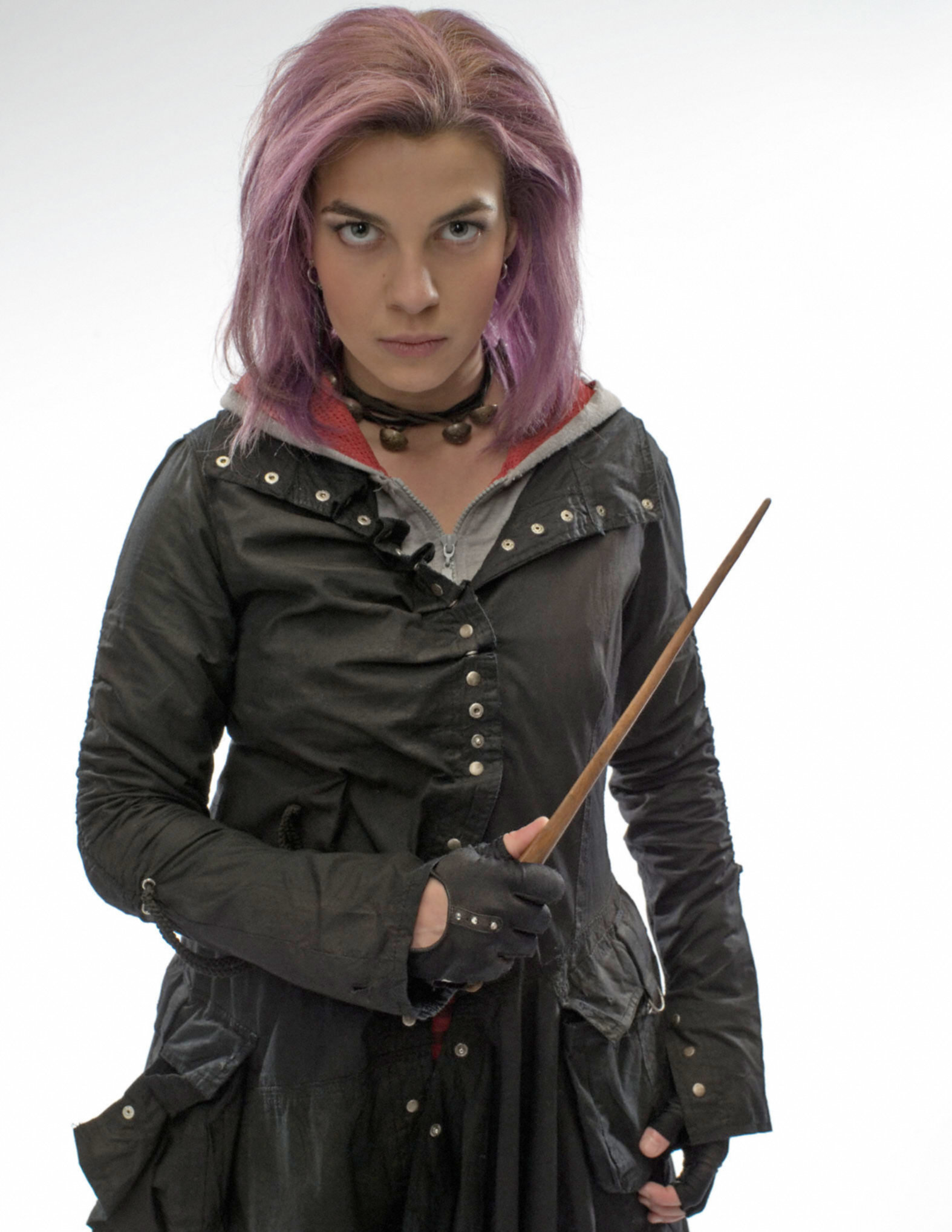Tonks with pink hair and her wand from the Order of the Pheonix