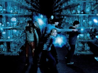Hermione leads the attack in the Hall of Prophecy.