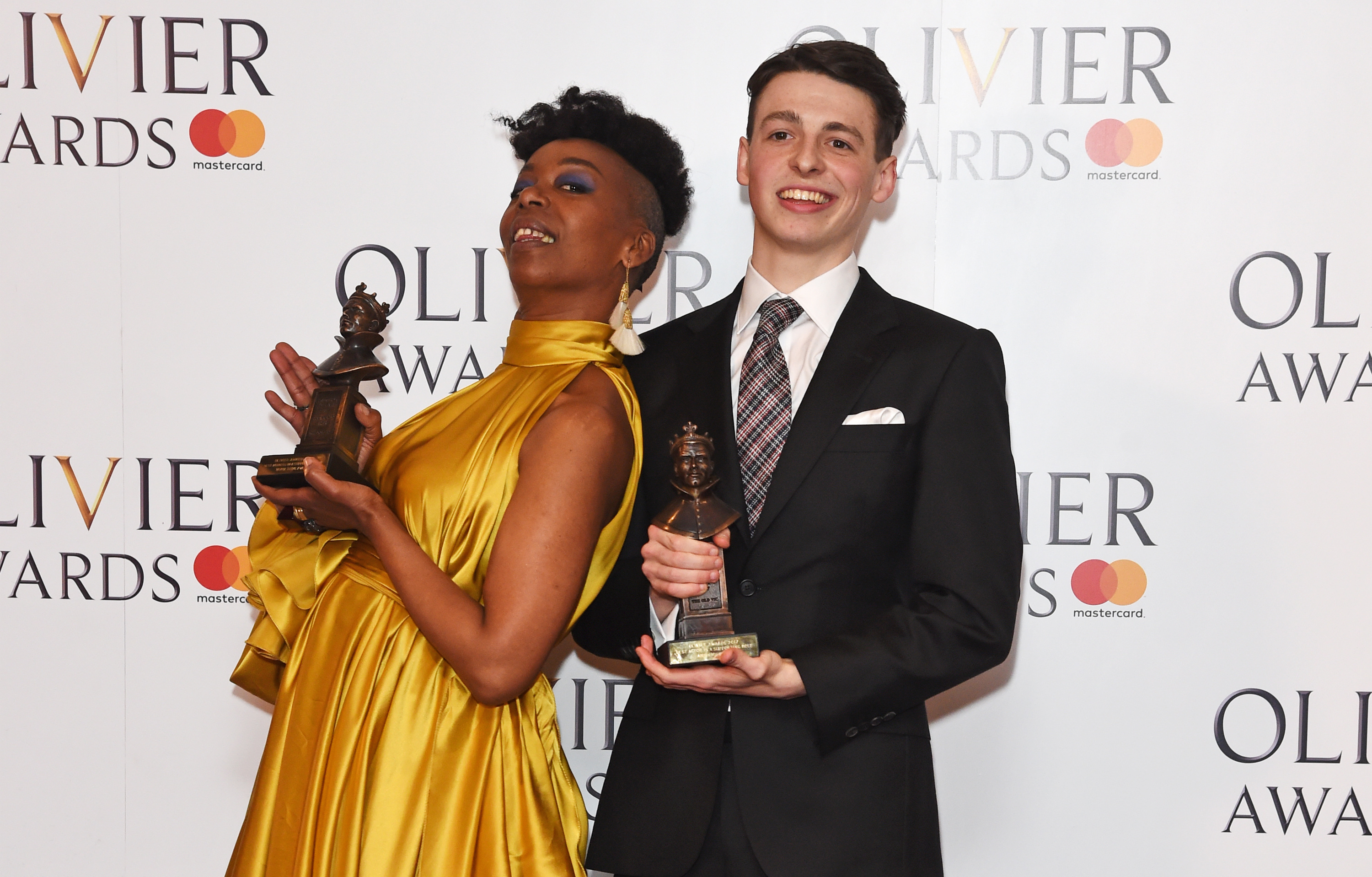 Cursed Child actors Noma Dumezweni and Anthony Boyle, with their Olivier Awards.