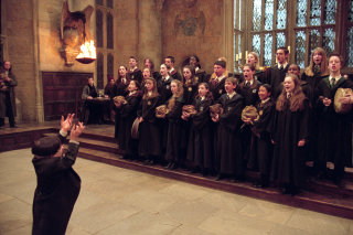 Flitwick conducts the school choir.