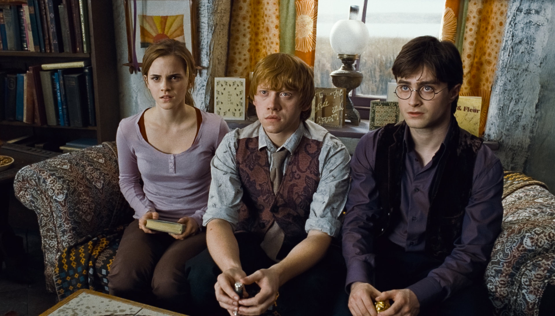 Harry Ron and Hermione sitting at the Burrow for Dumbledore's will