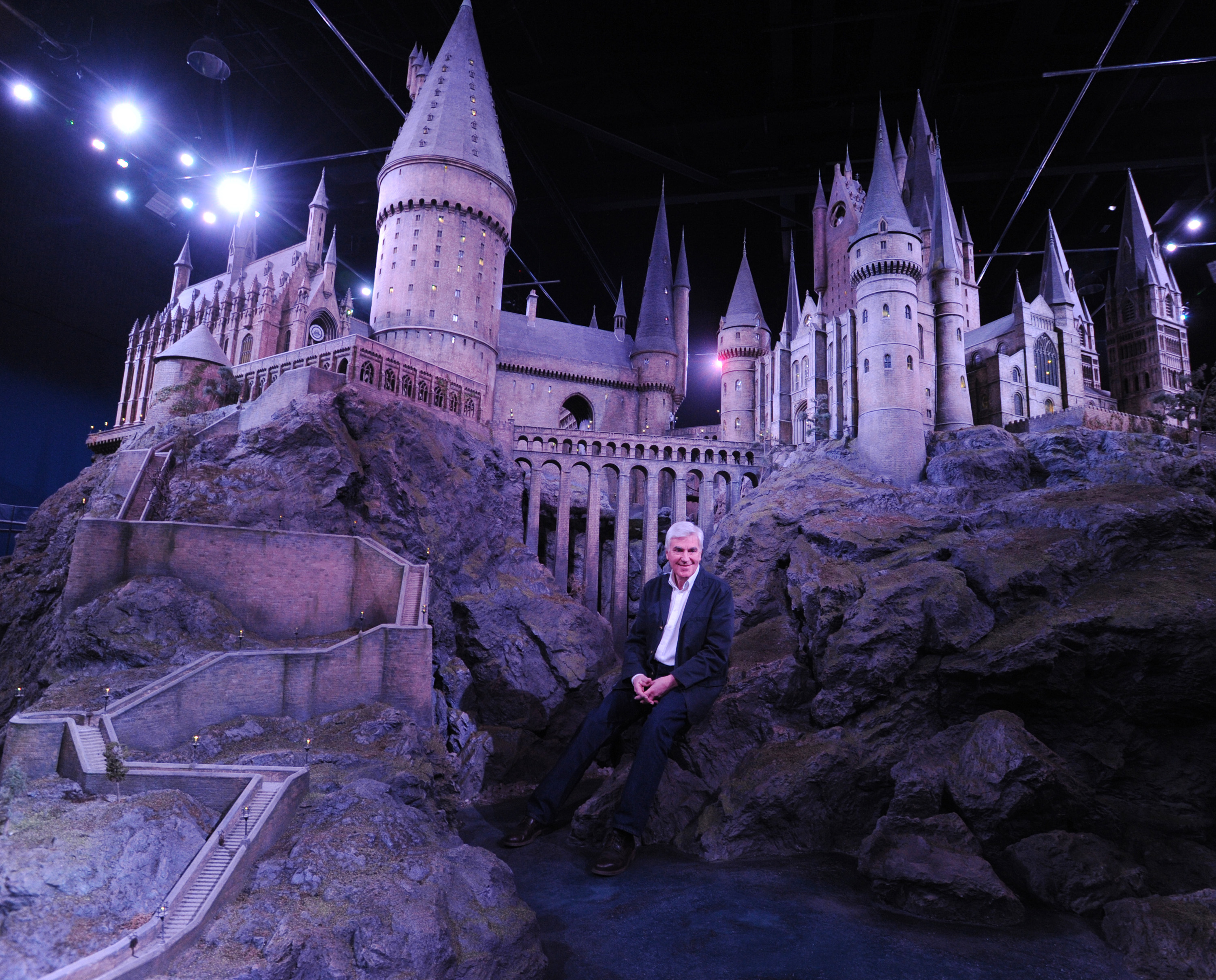 Production designer Stuart Craig, in front of the famous Hogwarts castle model at Warner Bros. Studio Tour London.