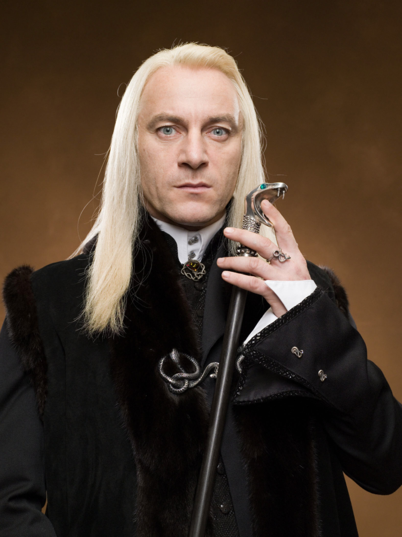 Lucius looks intimidating holding his cane from the Chamber of Secrets
