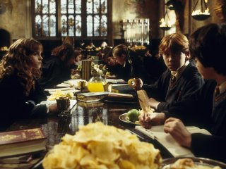 Ron Harry and Hermione at the Gryffindor table from the Chamber of Secrets