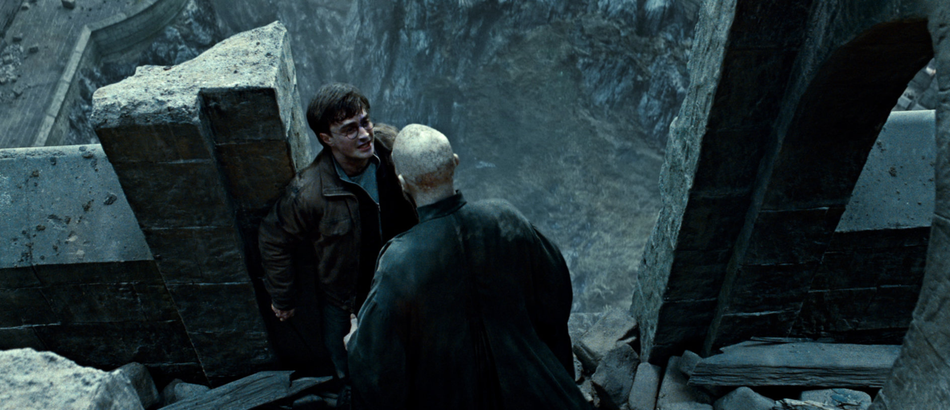 Voldemort and Harry at the edge of tallest tower in Hogwarts from the Deathly Hallows Part 2