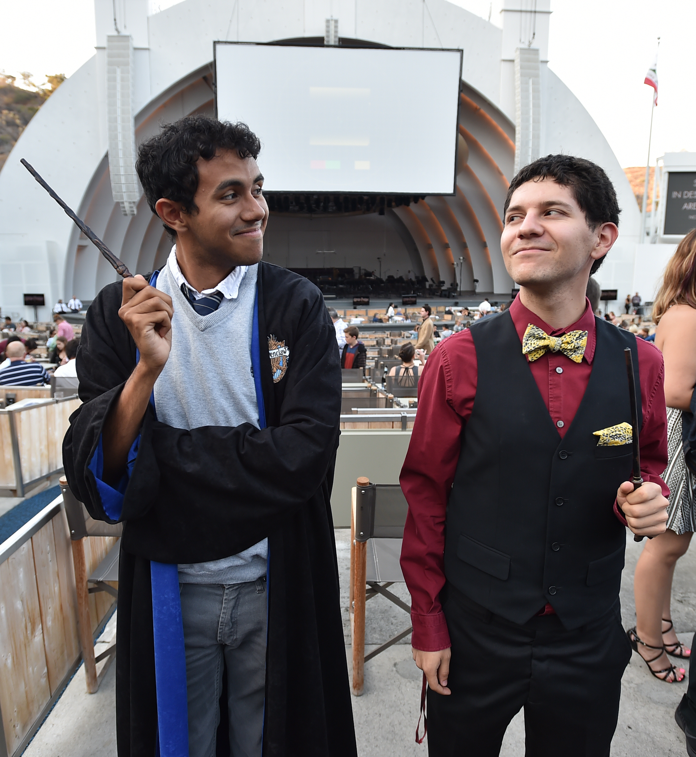 Two Harry Potter fans, with wands, getting ready for the show at Hollywood Bowl