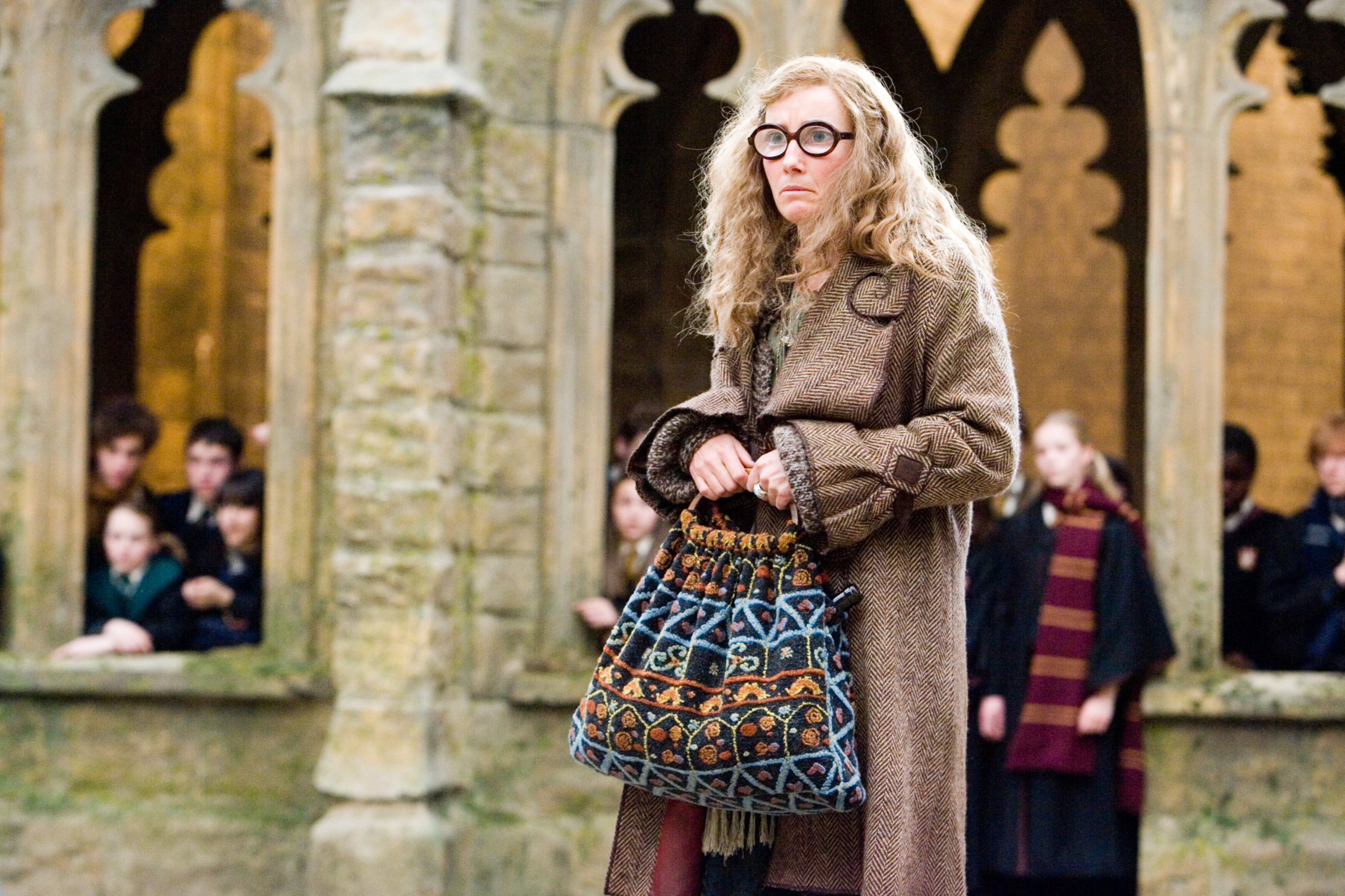 Sybil Trelawney clutches her bag after being fired by Umbridge in the Order of the Pheonix