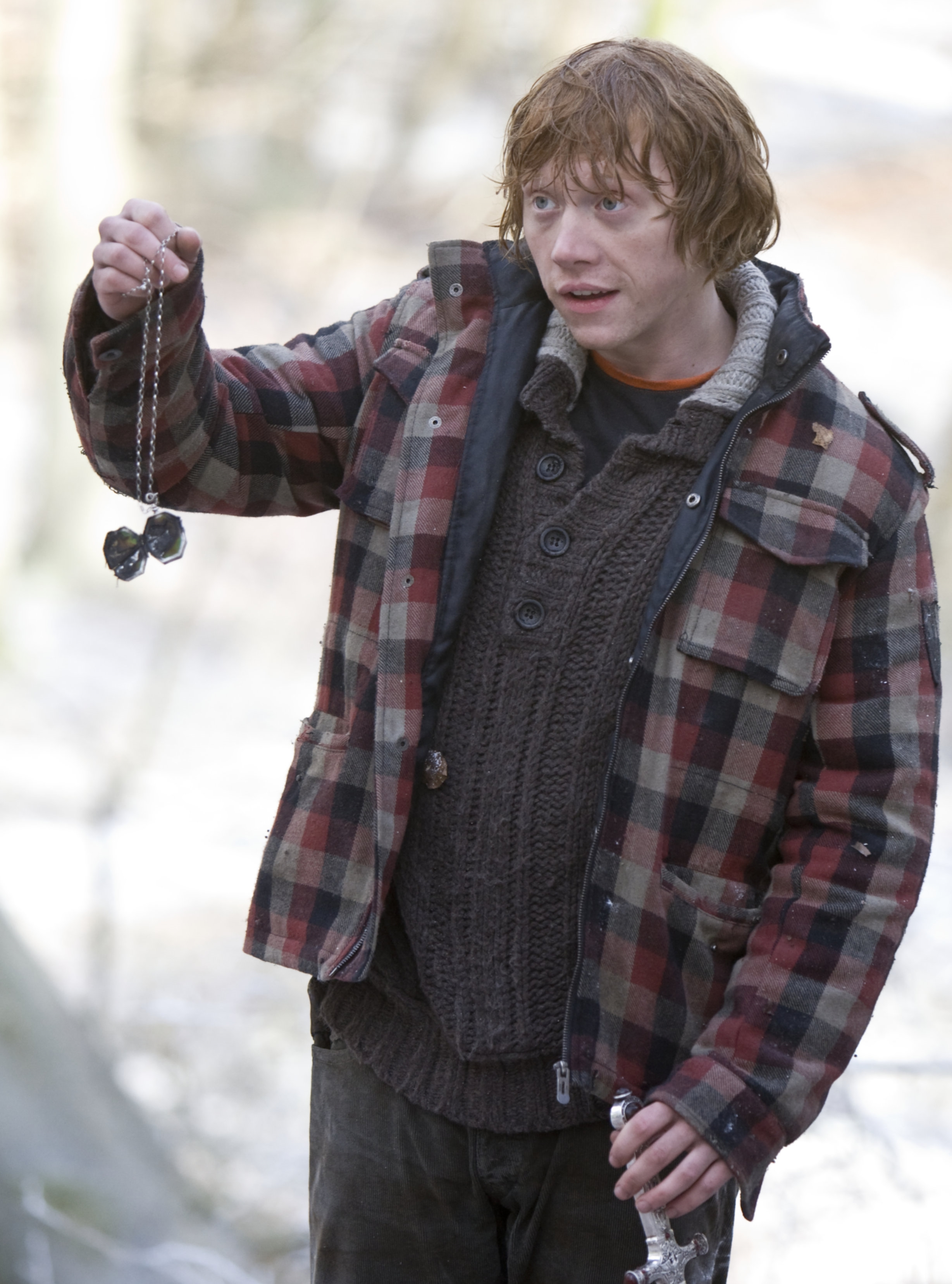 Ron holding up the destroyed locket Horcrux.