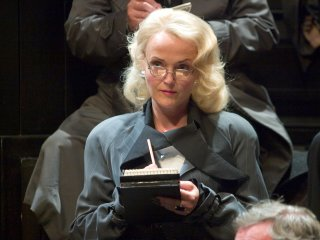 Rita Skeeter taking notes during the trial of Igor Karkaroff in the Goblet of Fire.
