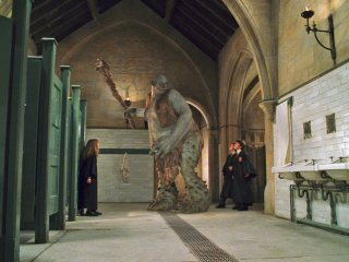 Hermione face to face with the Troll in the girls bathroom