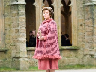 Umbridge sneers at Professor Trelawney in the Hogwarts courtyard.