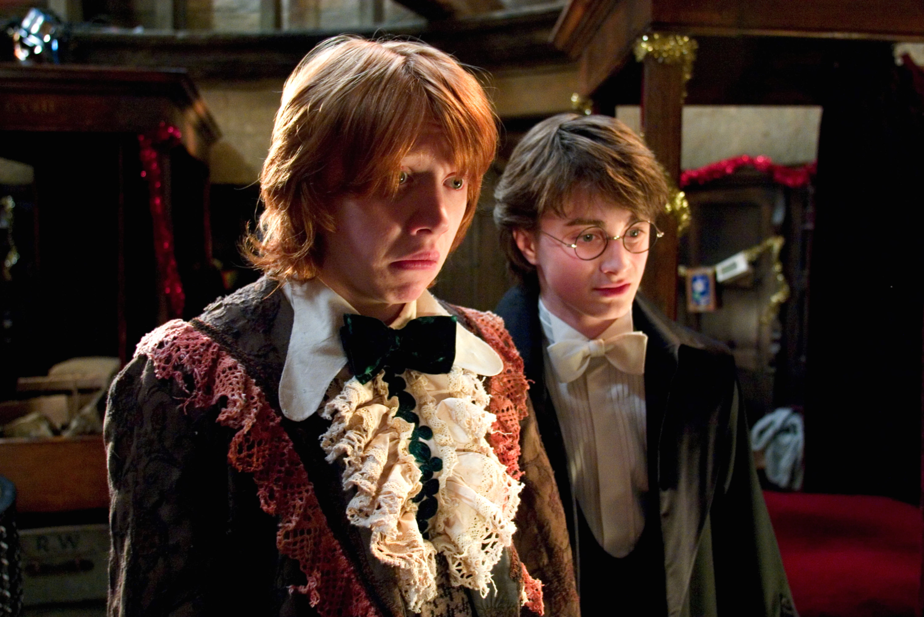 Ron and Harry looking at their dress robes from the Goblet of Fire